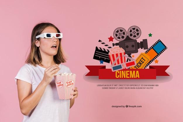 Mulher jovem e bonita comendo pipoca com óculos 3-d ao lado de elementos de cinema desenhados à mão