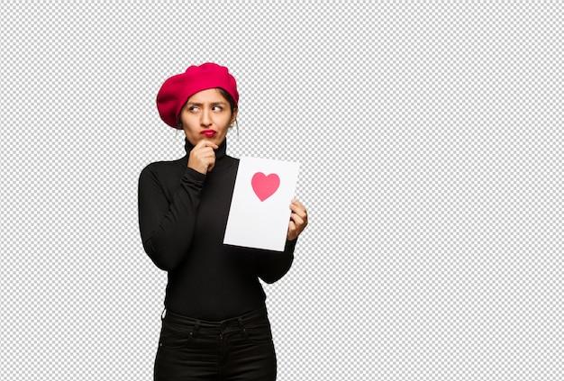 Mulher jovem, em, valentines day, duvidando, e, confundido