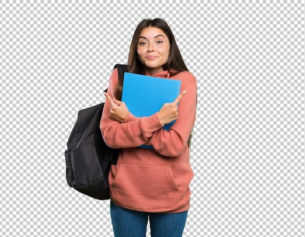 Mulher jovem, estudante, segurando, cadernos, apontar, para, a, laterals, tendo, dúvidas