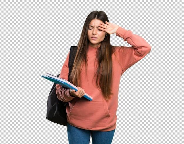 Mulher jovem, estudante, segurando, cadernos, com, cansado, e, expressão doente