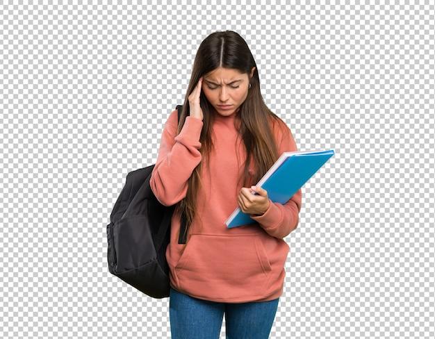 Mulher jovem, estudante, segurando, cadernos, com, dor de cabeça