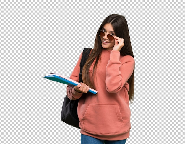 Mulher jovem, estudante, segurando, cadernos, com, óculos, e, feliz