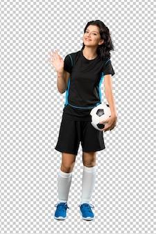 Mulher jovem, jogador de futebol, saudando, com, mão, com, feliz, expressão