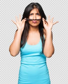 Mulher latina, fazendo, bigode, gesto