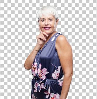 Mulher legal sênior com um olhar orgulhoso, confiante e feliz, sorrindo e se sentindo bem