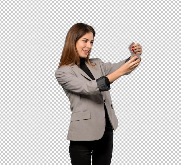 Mulher negócio, fazendo, um, selfie