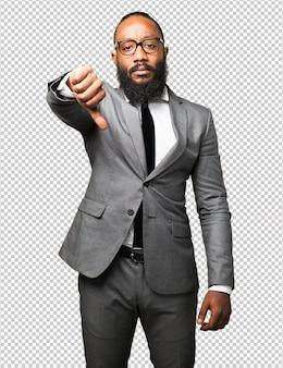 Negócios homem negro polegar para baixo