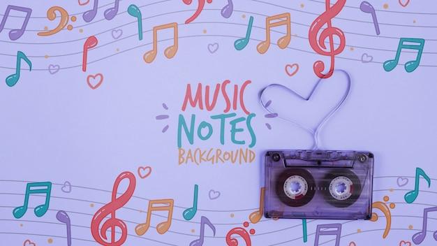 Notas musicais na folha com fita ao lado