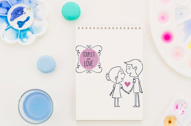 Notebook com casal apaixonado desenho