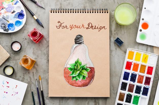 Notebook com desenho realista e colorido