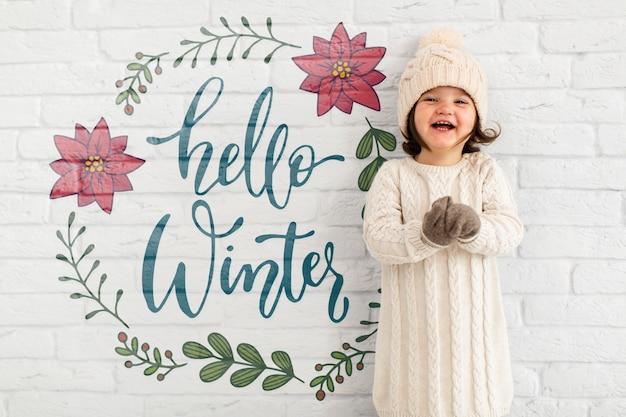 Olá maquete de inverno com criança adorável