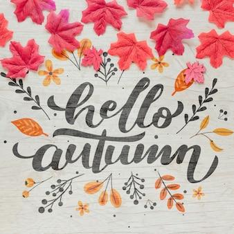 Olá outono caligrafia com folhas secas rosa