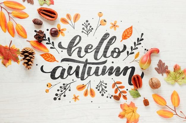 Olá outono caligrafia com folhas