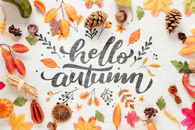 Olá outono caligrafia rodeada de decoração de outono