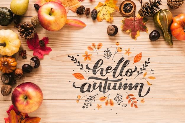Olá outono citação com folhas e maçãs