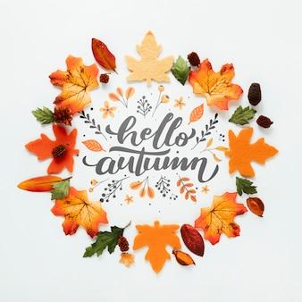 Olá outono citação com folhas em tons de laranja