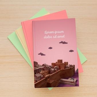 Os livros minimalistas da vista superior cobrem a composição do mock-up