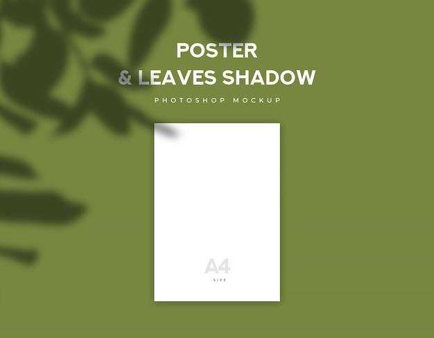Papel de cartaz branco ou tamanho de folheto a4 e folhas de sombra sobre fundo verde-oliva