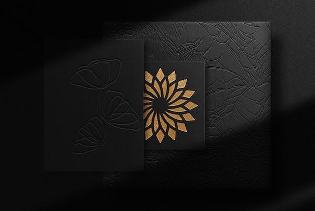 Papel de luxo em relevo dourado e maquete de cartão de visita