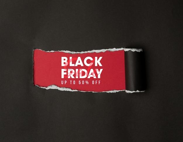 Papel rasgado preto e o texto maquete de venda na sexta-feira preta para seu projeto