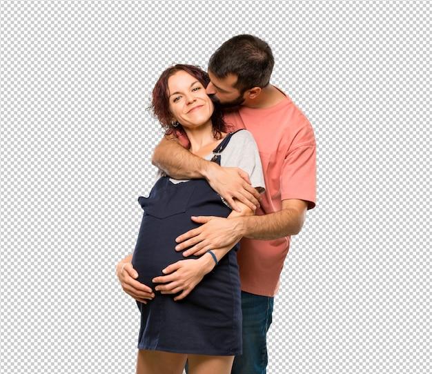 Par, com, mulher grávida, abraçando