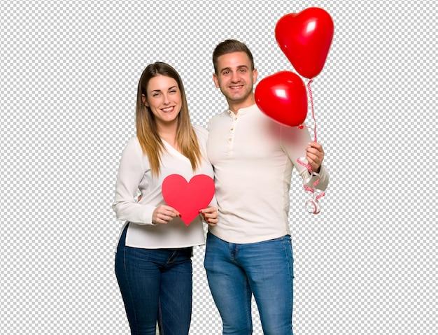 Par, dia valentine, segurando, um, coração, símbolo, e, balões