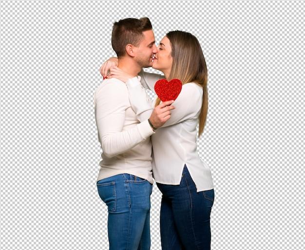Par, dia valentine, segurando, um, coração, símbolo, e, beijando