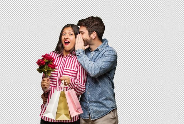 Par jovem, em, dia valentines, sussurrando, fofoca, submissão