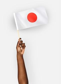 Pessoa, waving, a, bandeira, de, japão