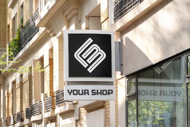 Placa de sinal da marca da loja mockup