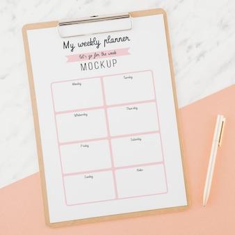 Planejador semanal de vista superior com maquete