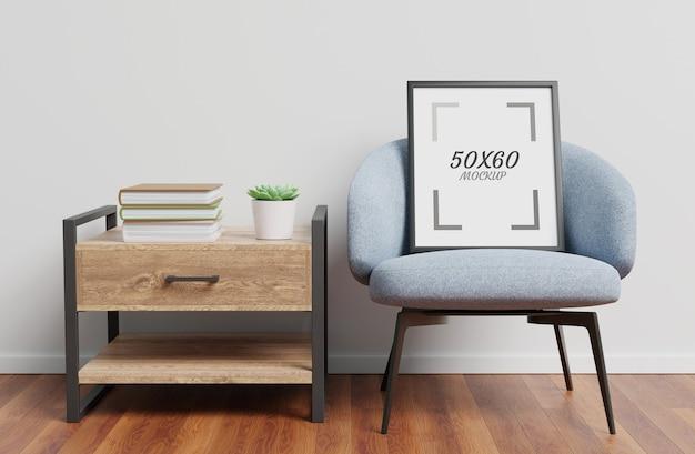 Poltrona, mesa de madeira e maquete de moldura na sala de estar em renderização 3d