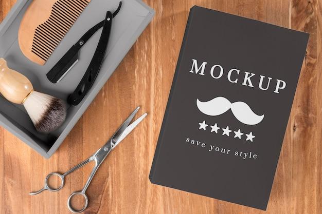 Posição plana de produtos de barbearia com tesoura