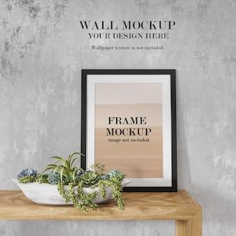 Pôster preto e maquete de parede para seu projeto