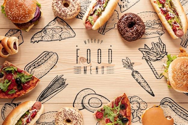 Postura plana de deliciosa comida rápida na mesa de madeira