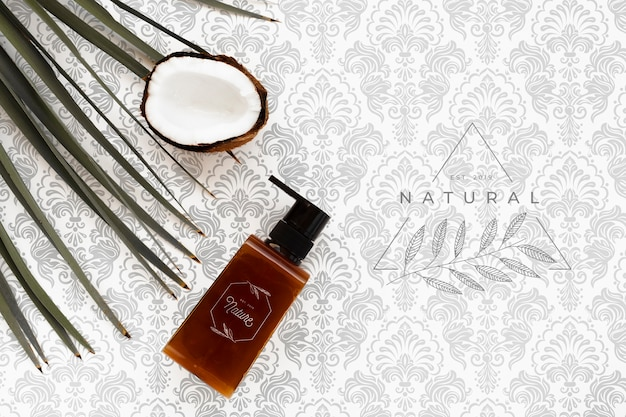 Postura plana de frasco de óleo essencial com coco
