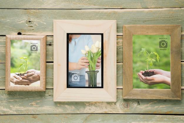Postura plana de variedade de quadros em fundo de madeira