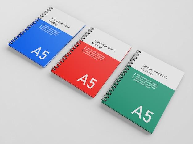 Prémio três bussiness capa dura espiral fichário notebook a5 mock up modelo de design na vista em perspectiva superior direito