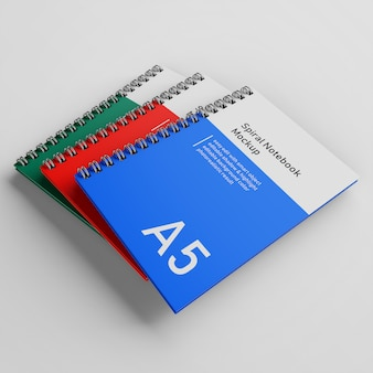 Premium três escritório capa dura espiral fichário a5 notebook mock up modelo de design empilhado em três quartos vista