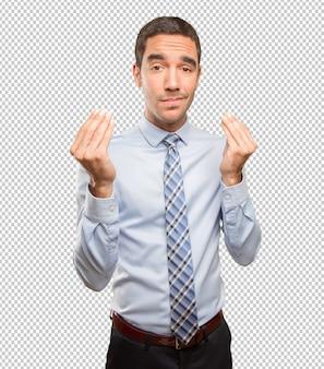 Preocupado empresário fazendo um gesto confuso