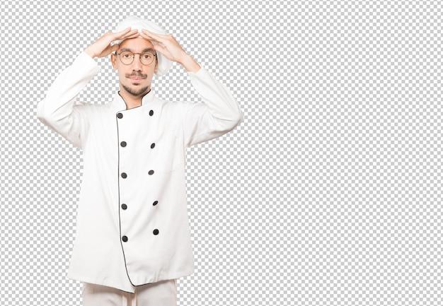 Preocupado jovem chef com um gesto de estresse