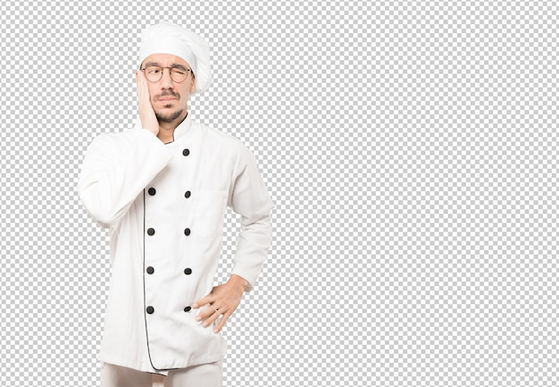 Preocupado jovem chef fazendo um gesto de alívio