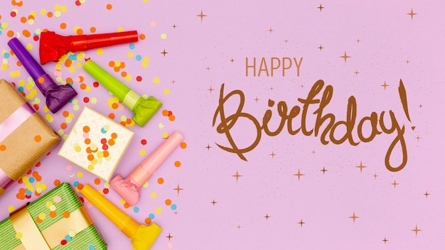 Presentes e confetes ao lado da mensagem de feliz aniversário