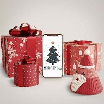 Presentes embrulhados e telefone na mesa