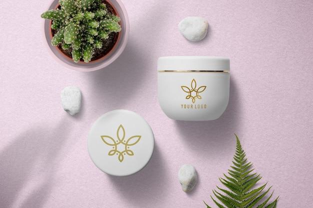 Projeto da maquete do logotipo do frasco de creme para cosméticos