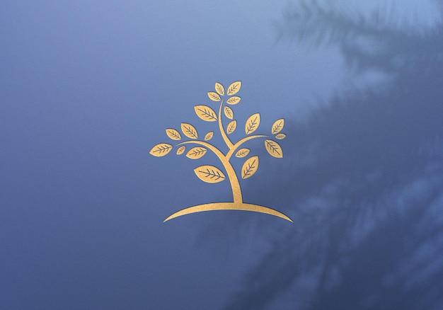 Projeto da maquete do logotipo dourado com sombra