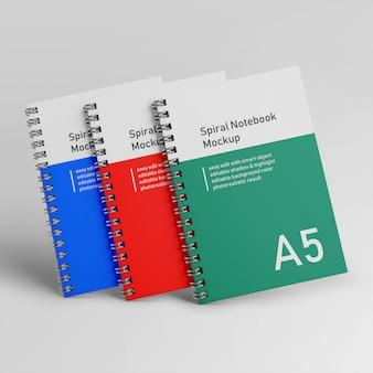 Pronto para usar três capa dura de pasta de empresa espiral livro de nota mock up modelo de design na frente de vista