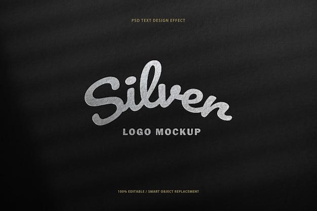 Protótipo de maquete de papel preto com efeito de carimbo do logotipo de folha de prata.