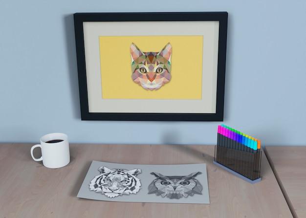 Quadro com desenho de gato e folha ao lado
