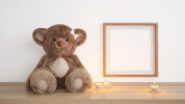 Quadro em branco com ursinho de pelúcia e velas
